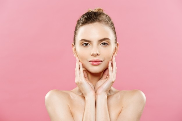 beauty-concept-beautiful-caucasian-woman-with-clean-skin-natural-make-up-isolated-bright-pink-background-with-copy-space_1258-1031